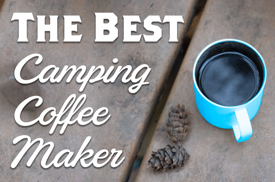 A mug of coffee sits on a picnic table and the text The Best Camping Coffee Maker