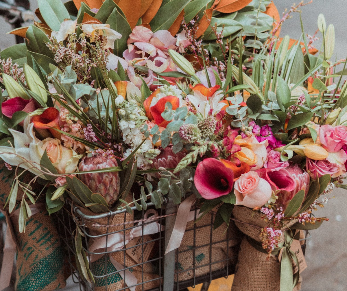 basket full of flowers wrapped with burlap