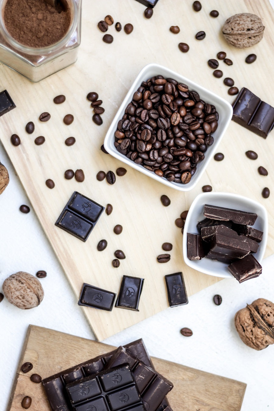 coffee beans and chocolate spread over a table