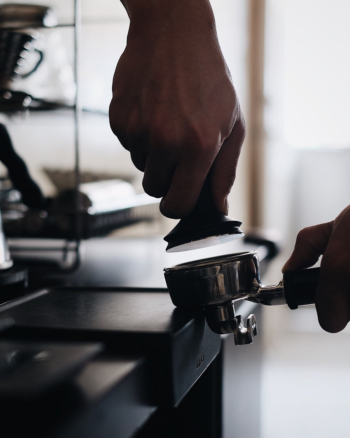 tamping an espresso shot