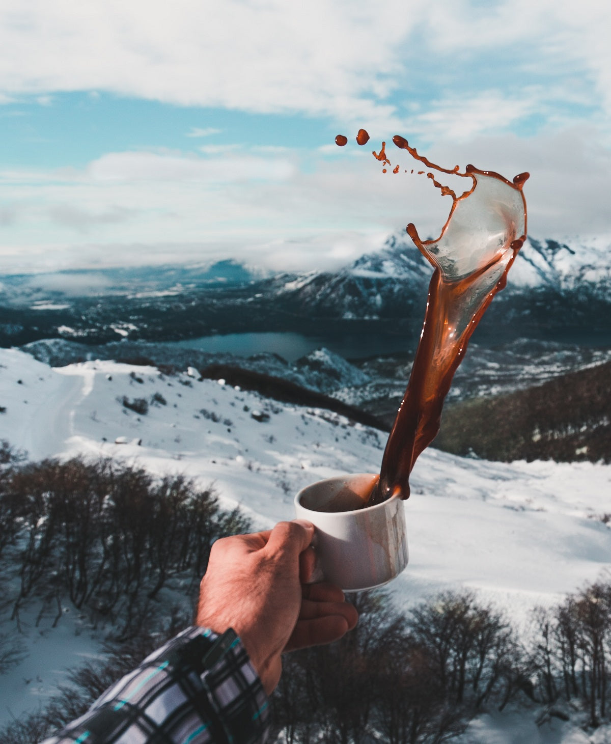 image tossing coffee with mountains in background