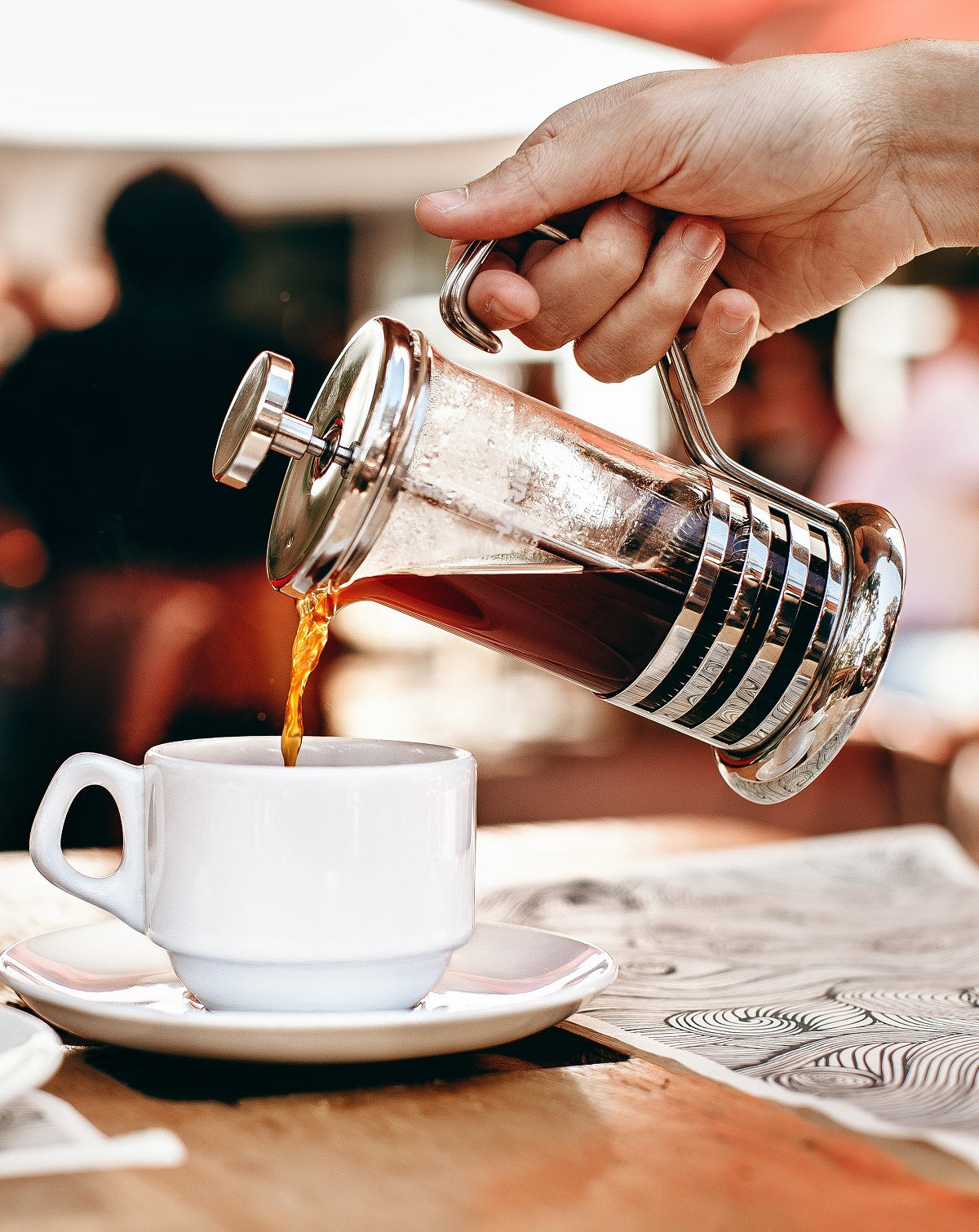 pouring a cup of coffee from FrenchPress
