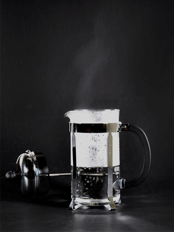 How to use a French Press - A photograph of a french press being pre-warmed with hot water.