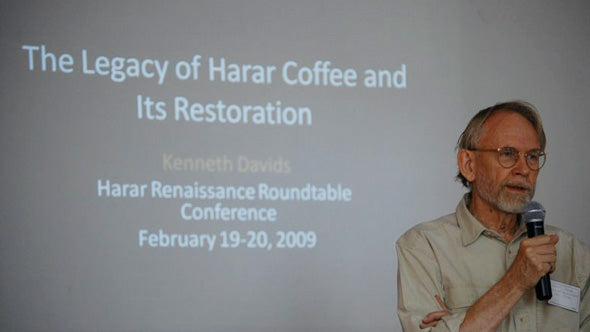 Ken Davids of Coffee Review on stage giving a lecture