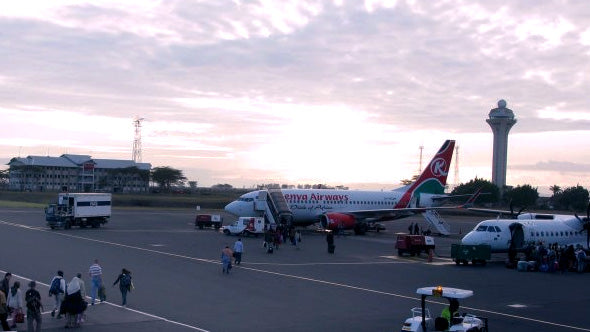 a view of the airstrip of the Kenya airport with a Kenya Airways plane waiting takeoff