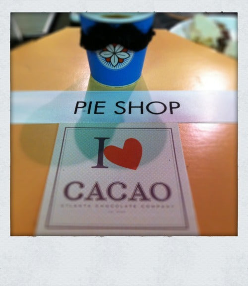 a blue batdorf branded cup sits alongside stickers from Cacao Atl and Pie Shop