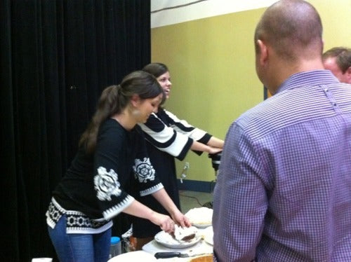 Pie Shop staff dealing out slices to attendees