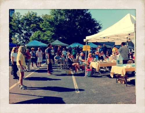 booths and shoppers at the Peachtree Farmer's Market