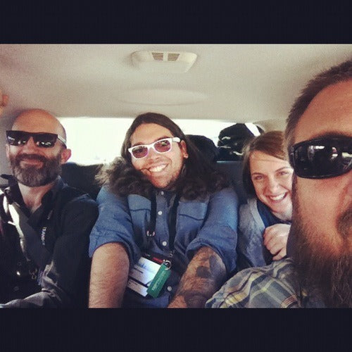 the Batdorf crew crammed into the backseat of a compact car