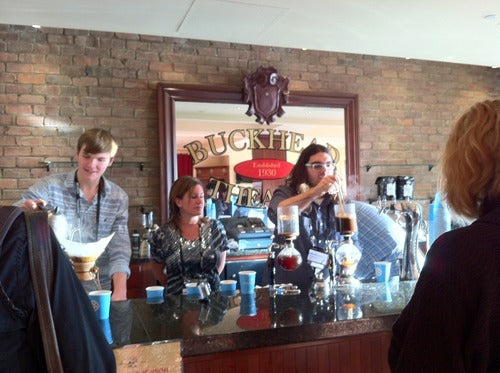 Batdorf staff demonstrating two different brewing methods siphon and Chemex