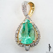 7.65 CT. Diamond and Emerald Ladies Pendant in 14K Yellow Gold