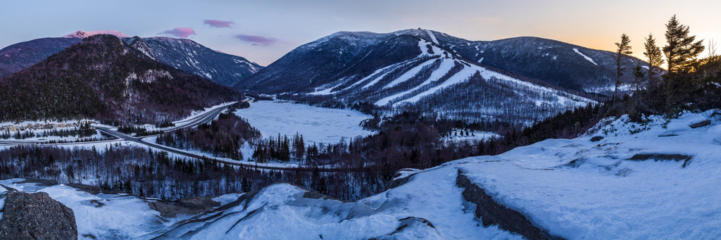 A winter sunset over Franconia Notch State Park and Cannon Mountain.