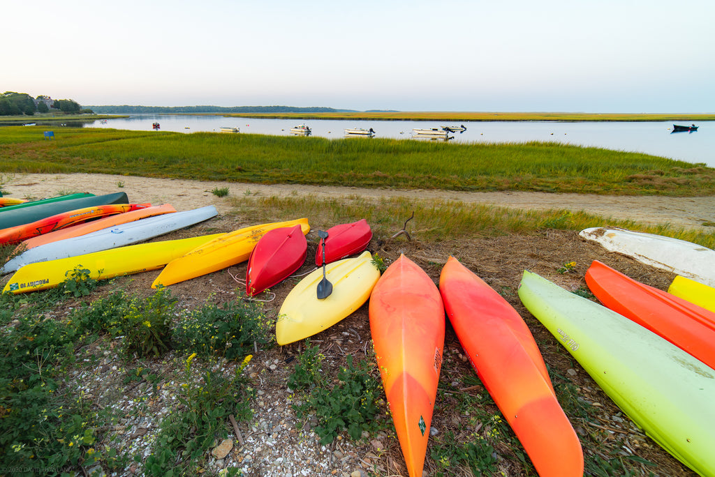 Colorful kayaks on the shore at Hemenway Landing in Eastham.