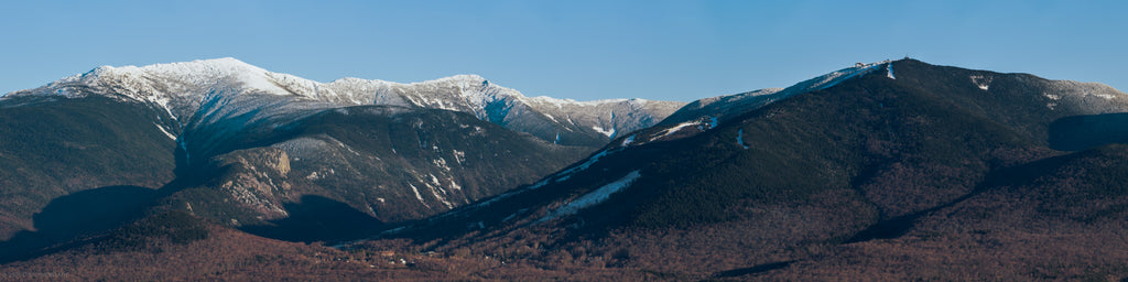 Early season snow on the peaks of Franconia Notch State Park.