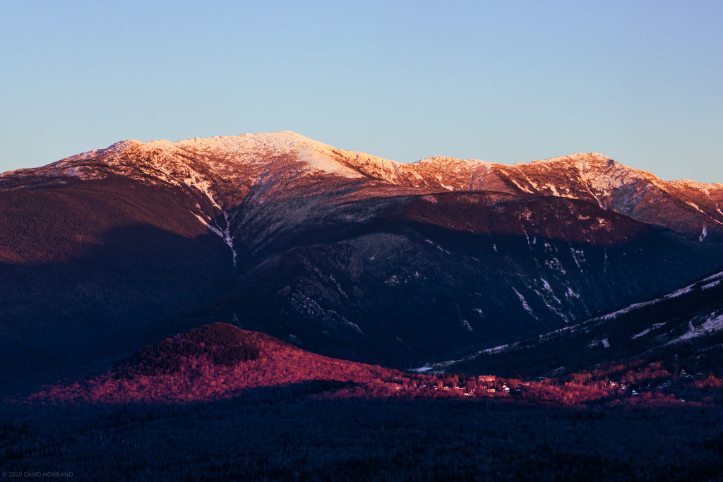 Sunset alpenglow and snow on Franconia Ridge.
