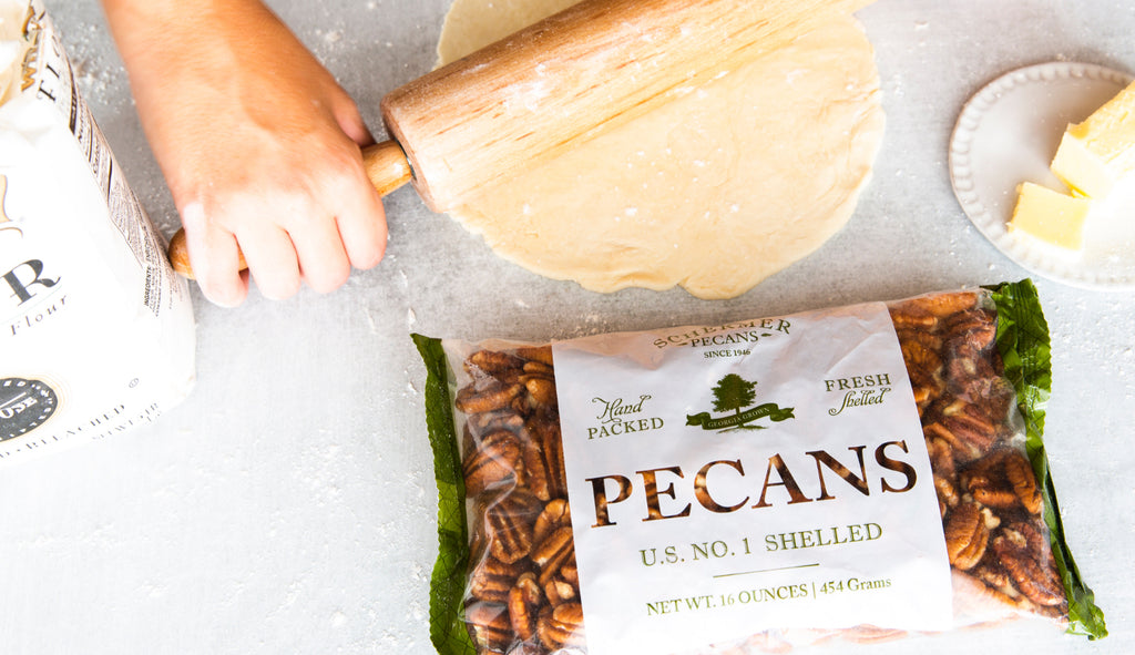 Rolling out a pie crust with Schermer Pecans