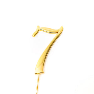 Metal cake topper with the number 7 in Gold