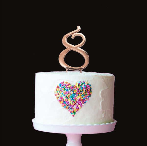 Metal cake topper with the number 8 in Rose Gold