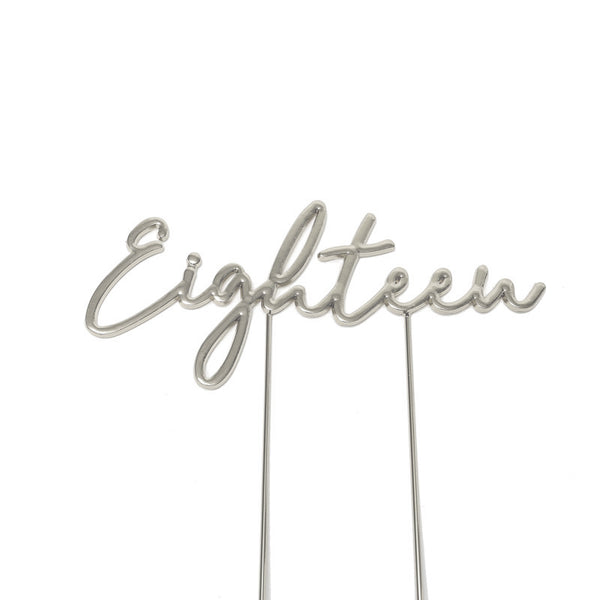 Metal cake topper with the word Eighteen in Silver
