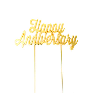 Metal cake topper with the words Happy Anniversary in Gold