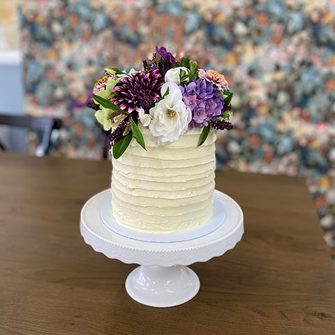 Rustic textured icing, full fresh floral cake from Sweet Creations NZ