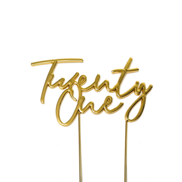 Metal cake topper with the words Twenty One in Gold