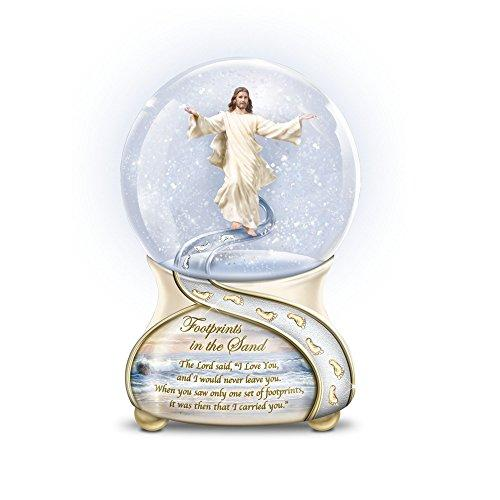 'Footprints In The Sand' Musical Glitter Globe With Jesus Sculpture. Porcelain Base Showcases Poem, Golden Footprints, Sharon Rickert's Art And 22-Carat Gold-Plated Trim Exclusively From The Bradford Exchange