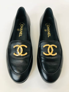CHANEL Black Leather Loafers With Gold CC and Pearl Size 37 1/2