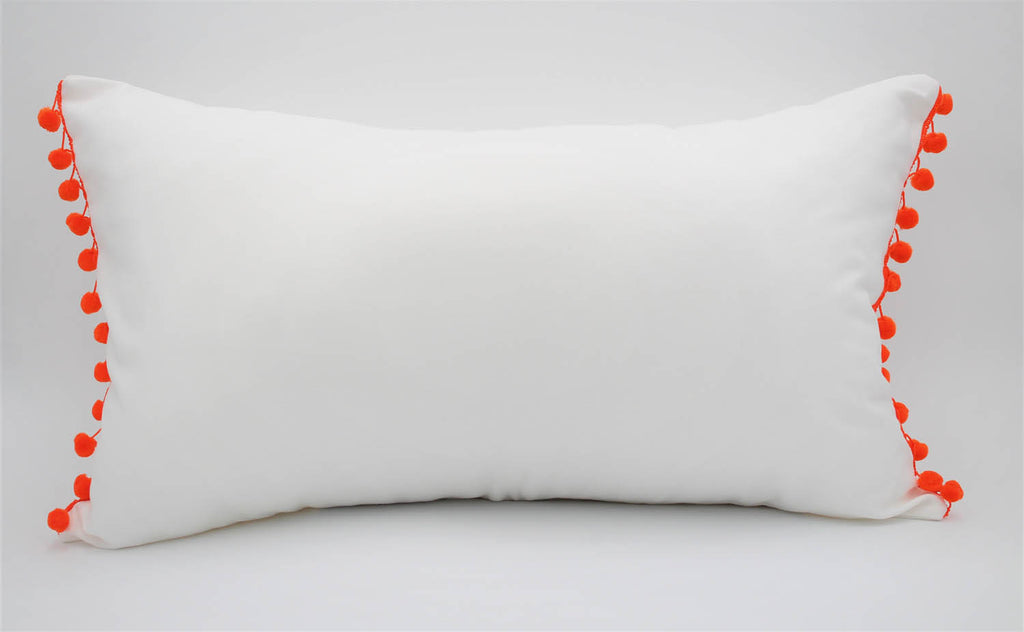 El Mar Pillow Collection: White with Orange Pom Poms