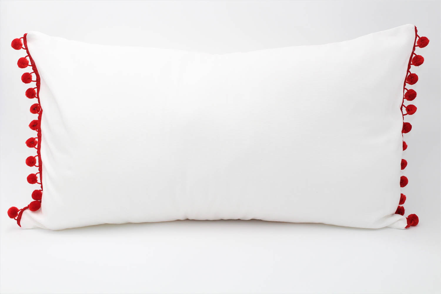 El Mar Pillow Collection: White with Red Pom Poms