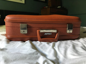 Retro orange Impala suitcase