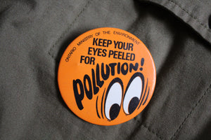 Retro Button - Orange Pollution