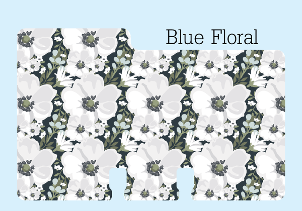"A sturdy Floral Rolodex Divider in pretty black, blue, gray, green and white print. It is on a pale blue background with the words ""Blue Floral."""