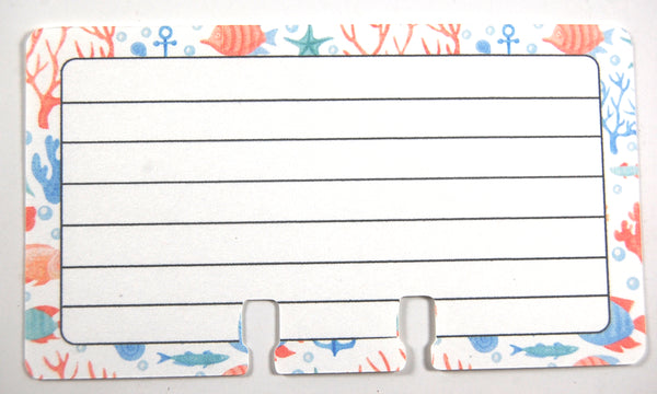 Lined Rolodex refill cards in a Coral Blue sea print. The center is white with 6 black lines for writing. The outer edge is decorated with a beachy print of fish, anchors, coral and bubbles in blue, green and orange.