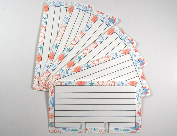 Many Coral Blue Sea lined Rolodex refill cards arranged in a fan pattern.