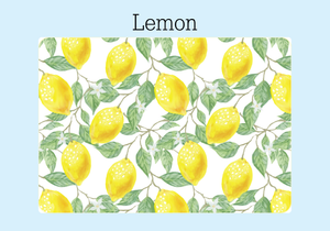 "The heavy duty front cover of a Lemon Password Keeper. The white background has yellow lemons, green leaves and white flowers. It is displayed on a pale blue background with the word ""Lemon."""