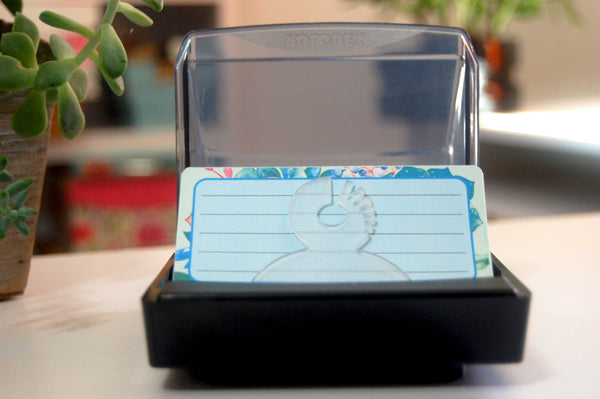 Printed Floral Rolodex Refill Cards. The cards are a pretty  succulent print in blue and mint green and pink. The lined cards are in a Rolodex holder with plants in the background.