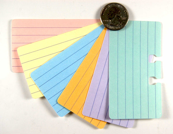 Tiny Lined Rolodex Cards in 6 pastel colors: pink, yellow, blue, orange, purple green. They are arranged in a fan and have a quarter for size comparison.