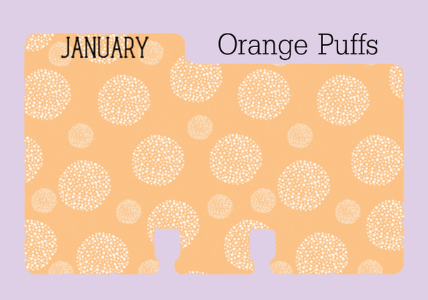 Rolodex Divider in orange with white puffballs