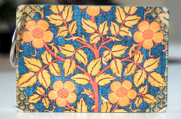 The back of a William Morris fabric print  password keeper in blue, orange and yellow.