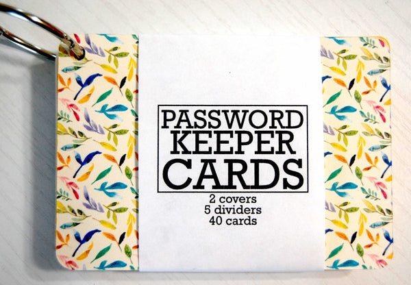 Password Keeper Cards on a ring. The cover is beige with a floral watercolor garden print. The wrapper shows that it contains 2 covers, 5 dividers and 40 cards.