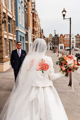 Image of bride with custom Wink Ink Design Co leather jacket featuring bold hand painted peonies from 2020 Wedding in Edmonton, Alberta, Canada. Photo Credit: Sarah Mavro Photography