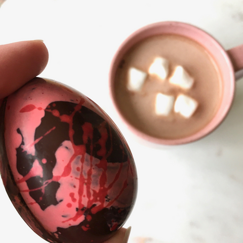 Dark chocolate hot cocoa filled eggs featuring two flavours, Raspberry Hot Cocoa and Dark Hot Cocoa from internationally award-winning chocolatier The Violet Chocolate Company featuring the 2021 Easter Collection