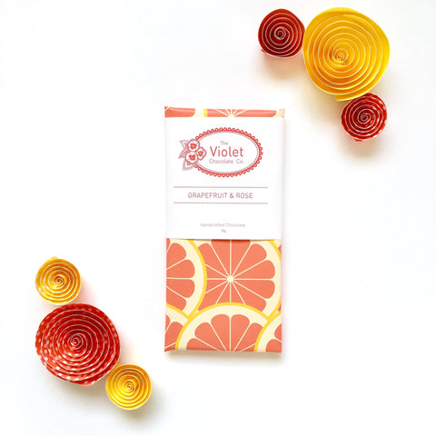 The Violet Chocolate Co. dark chocolate 78g bar wrapped in paper designed with bright bursts of grapefruit