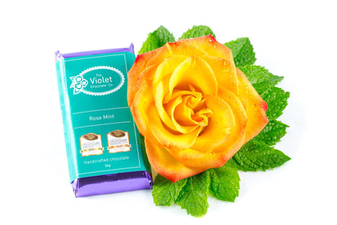 The Violet Chocolate Co. packaged dark chocolate Rose Mint bar next to yellow rose. International Chocolate Awards: Canadian - 2015 and 2014 Gold, International - 2014 Bronze