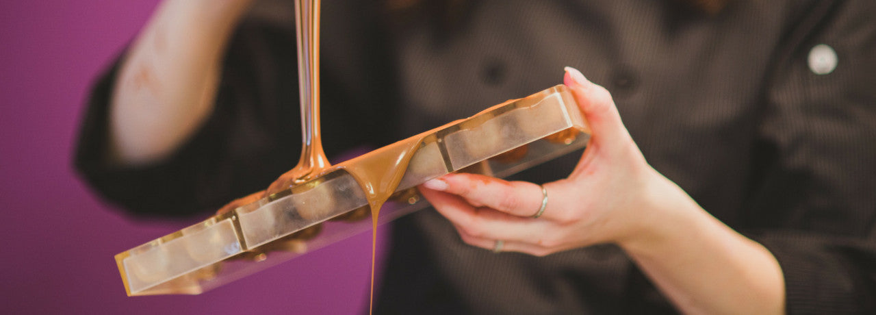 chocolate being poured into mould by The Violet Chocolate Company head chocolatier Rebecca