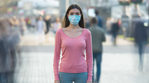 lady wearing a surgical mask