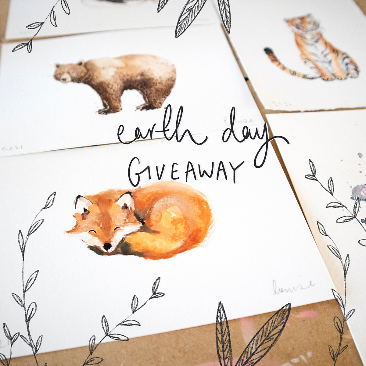 Earth Day illustrations of a fox, bear and tiger