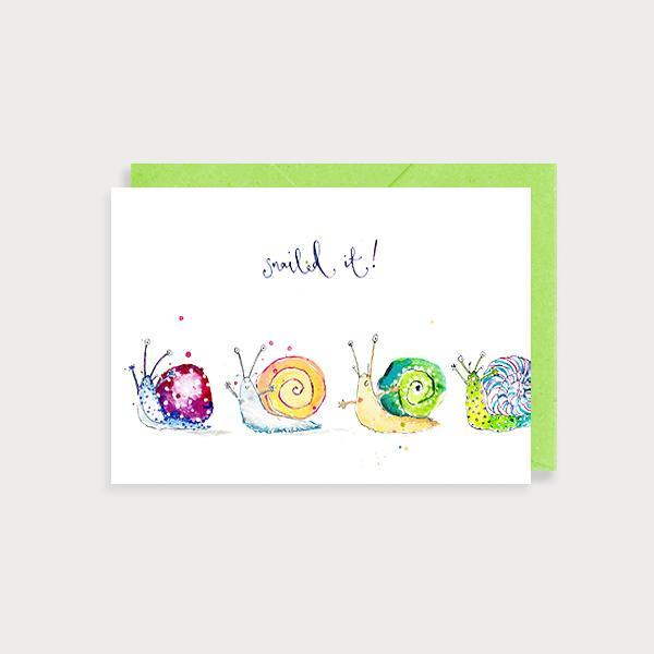 Image of illustrated congratulations card with four snails and the caption Snailed It!