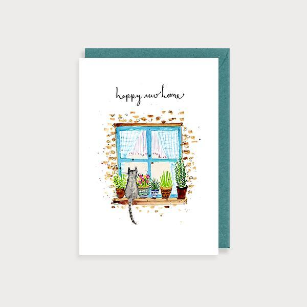Image of ilustrated new home card with a cat on a window sill and the caption Happy New Home